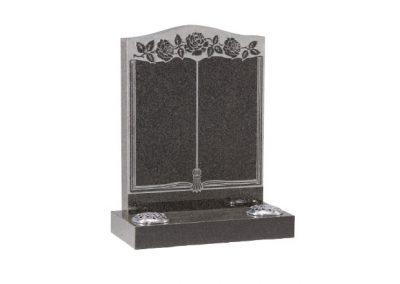 Dark grey granite headstone with embossed floral book design