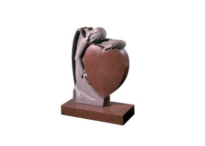 Ruby Red granite headstone with hand carved angel holding a heart