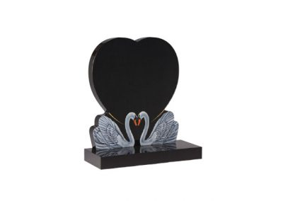 Black granite headstone with two etched and painted swans
