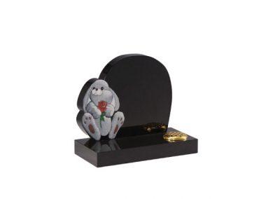 Black granite headstone with 'rabbit and rose' ornament