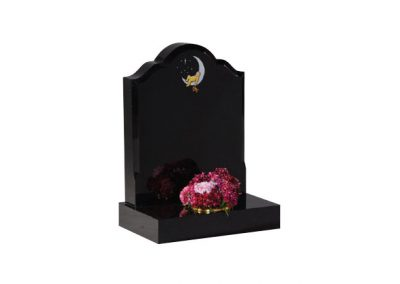 Black granite headstone with hand painted 'baby in moon' design