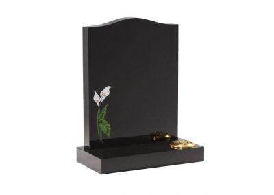 Black granite lawn memorial with etched and painted lily