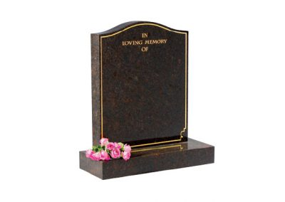 Granite headstone with gilded pin border