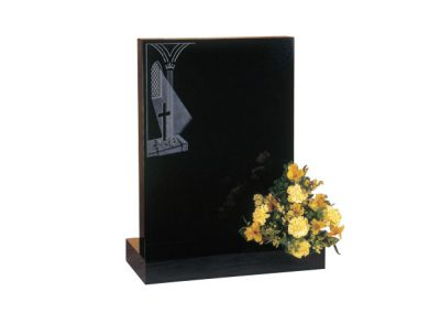 Black granite lawn memorial with etched church window design