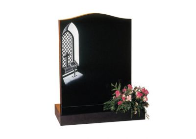 Black granite lawn memorial with etched 'church window' design