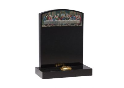 Black granite lawn memorial with etched and painted 'Last supper' design