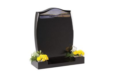 Black granite headstone with etched 'Morning by the Lake'