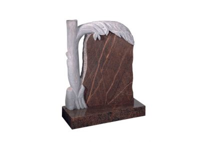 Red granite headstone with carved design