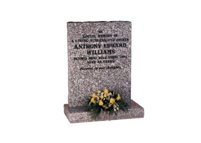 Mervyn Grey granite headstone with black painted inscription.