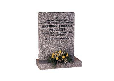Mervyn Grey granite headstone with black painted inscription.