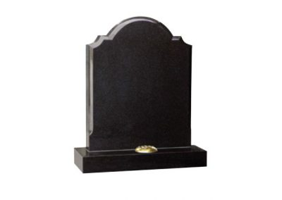 Black granite lawn memorial with shaped top with polished chamfer edges
