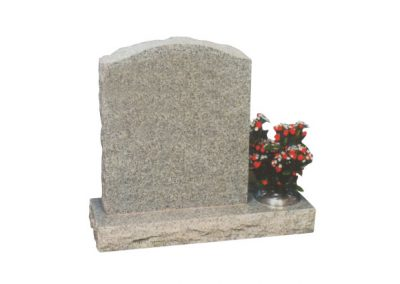 Light grey granite headstone with flower container