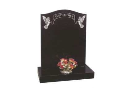 Black granite memorial headstone with fine etched dove & ribbon design.
