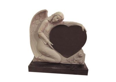 Black granite memorial headstone with carved angel cradling a heart