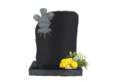 Black granite headstone with carved three feathers design
