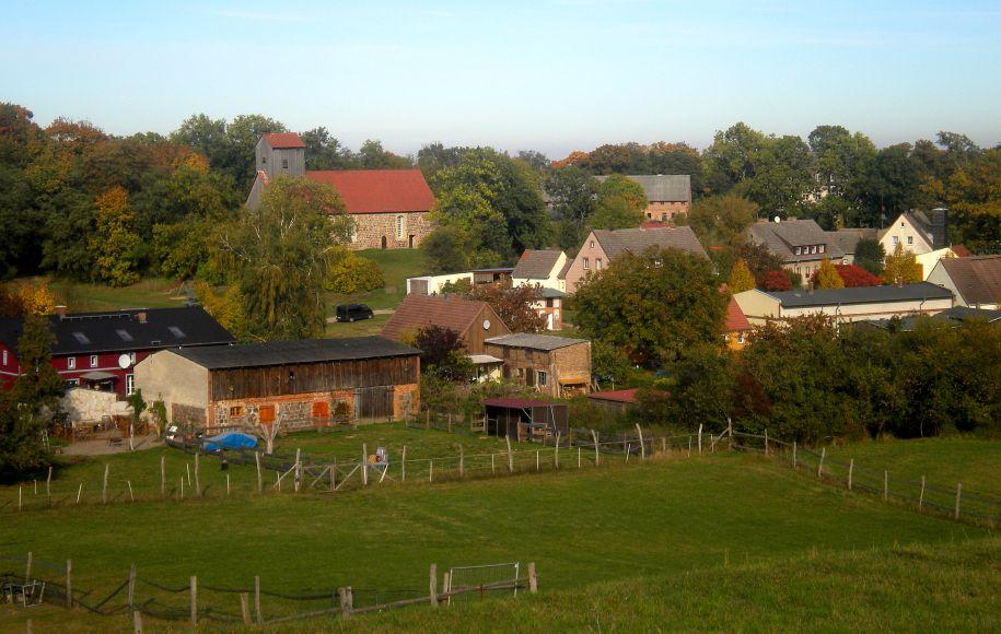 Green field with buildings in gross fredenwalde